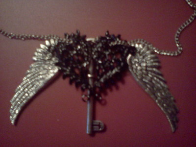 (>:D I feel like Obsidian now with my necklace. The wings are not attached yet because the chain refu