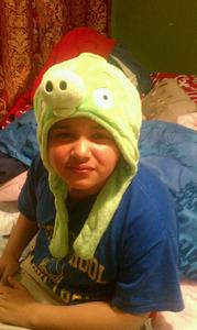well he got the gift its the pig hat from angry birds