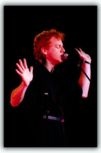 Danny Elfman  This is when he was younger and he was in a band called Oingo Boingo. I want him.