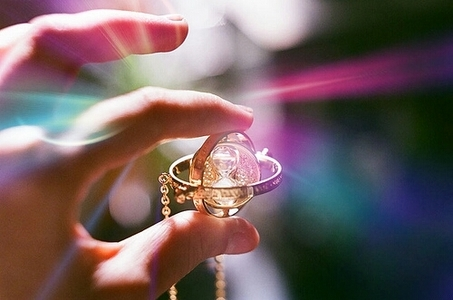 Tristain: It's a magical necklace that allows the user to time travel. ^.^ ...I think. XD  I took
