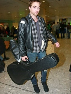 2) Holding guitar, gitaa