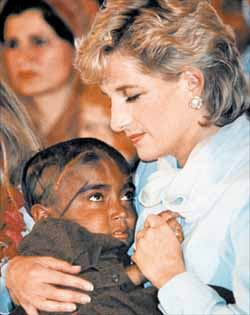 Do you know anything about this photo of Diana holding a child?  It looks like to source photo for a