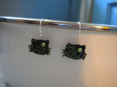 There are several different Hello Kitty Earrings for sale here: http://www.etsy.com/shop/Kristina823?