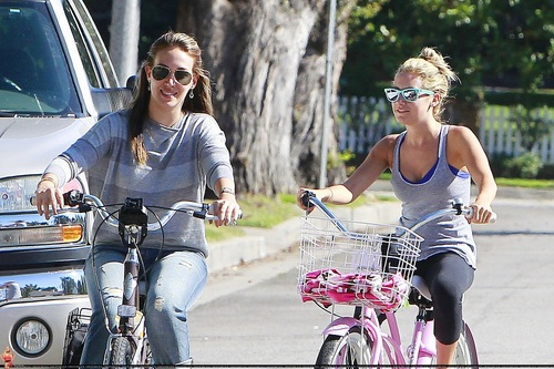 Ashley - Riding a bicycle with Haylie Duff - August 14, 2011