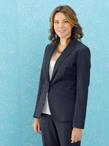 Christa Miller wallpaper containing a business suit, a suit, and a well dressed person called Christa Miller