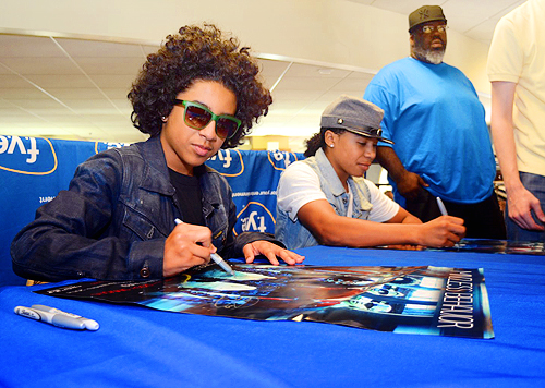 Princeton and Roc Royal signing autographs