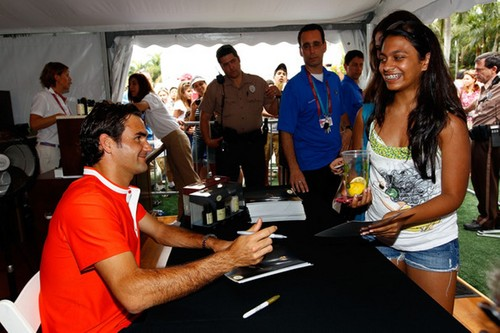 Federer signing autographs for some enthusiastic fan