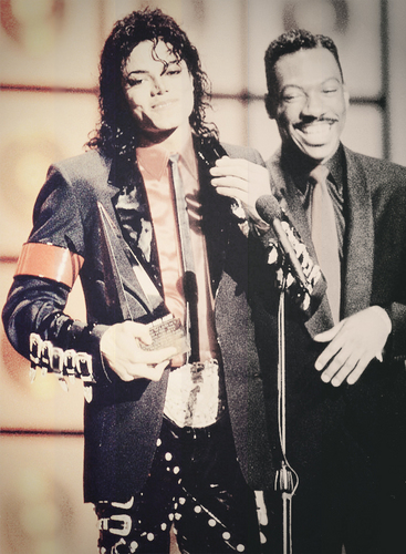 Accepting an award with Eddie Murphy