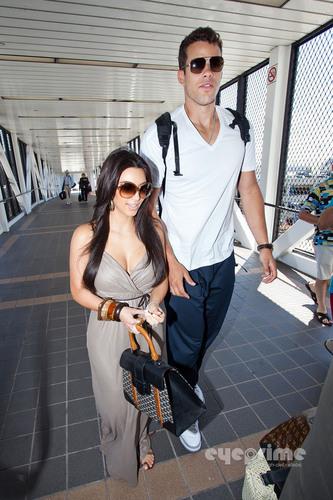 Kim Kardashian and husband Kris Humphries depart LAX, Aug 22