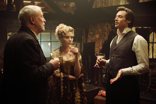 The Prestige hình nền probably containing a business suit called Robert Angier, Olivia Wenscombe & John Cutter