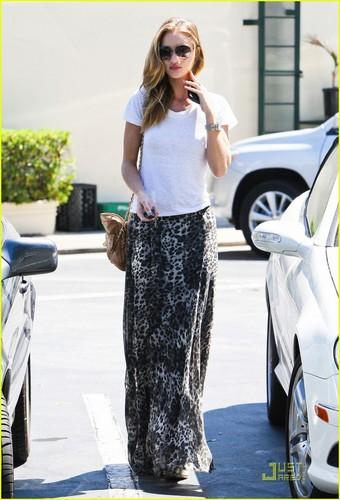Rosie Huntington-Whiteley and boyfriend Jason Statham leave Cafe Med on Monday (August 22)