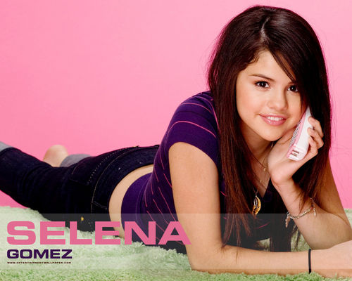 Selena Gomez wallpaper probably with a sign and a portrait called SELENA NEW WALLPAPERS