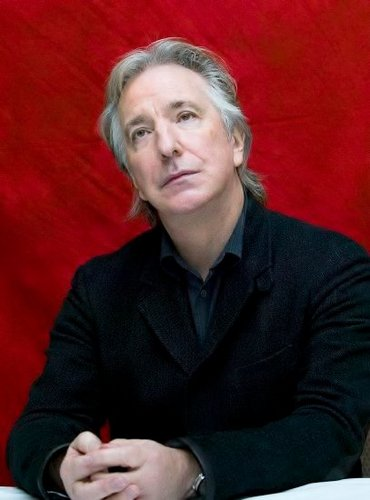 Alan Rickman wolpeyper possibly containing a well dressed person, a business suit, and a suit titled many madami Alan
