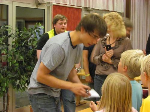 Alex signing autographs :)