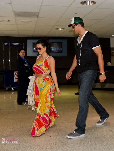 Kim And Kris Arrive To LAX- 8/26/11
