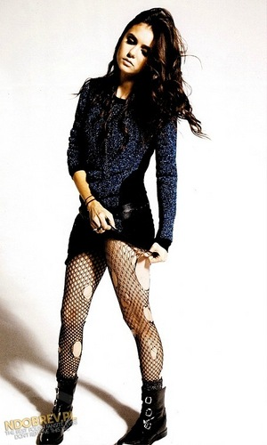 Nina Dobrev wolpeyper possibly containing hosiery, bare legs, and a hip boot entitled nylon