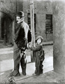 Charlie Chaplin and Jackie Coogan in The Kid (1921) - silent-movies photo