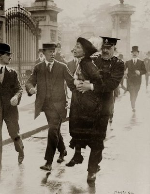Feminism wallpaper with a green beret and regimentals entitled Emmaline Pankhurst arrested outside Buckingham Palace standing up for women's rights