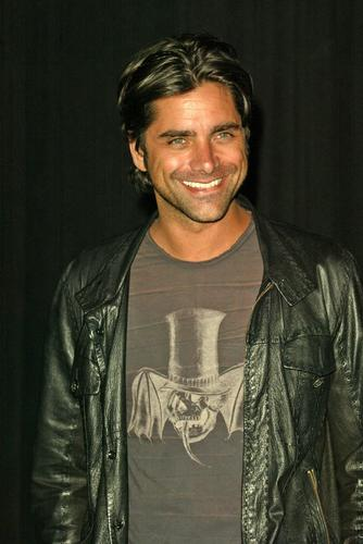 John Stamos wallpaper possibly containing a blouse, an outerwear, and a bomber jacket called John Stamos