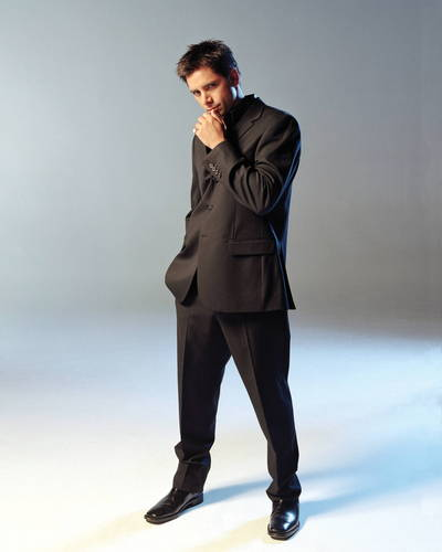 John Stamos wallpaper containing a business suit, a well dressed person, and a suit called John Stamos