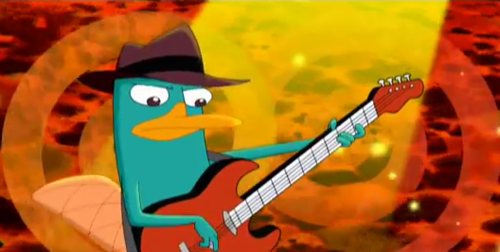 Perry playing the bass guitar