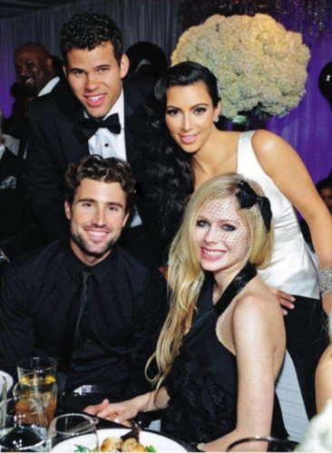 Avril and Brody posing with Kim Kardashian and Kris Humphries at their wedding