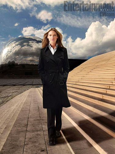 Fringe wallpaper containing a business suit, a suit, and a well dressed person entitled Season 4 Promotional Poster ~ Anna Torv as Olivia Dunham