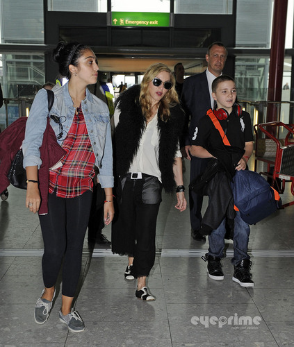 Мадонна and Family arrive at Heathrow Airport in London, Sept 4