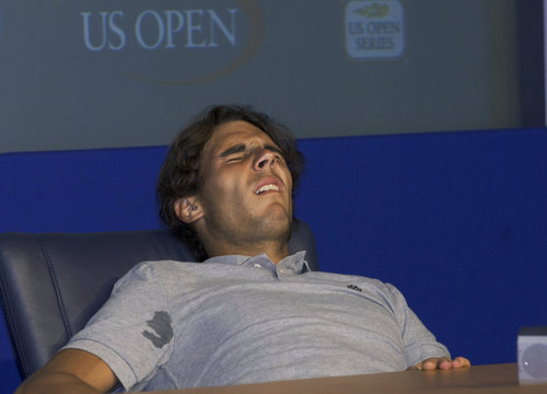 someone giving him a blowjob under the desk!!!!Nadal had a big cramp right at press conference