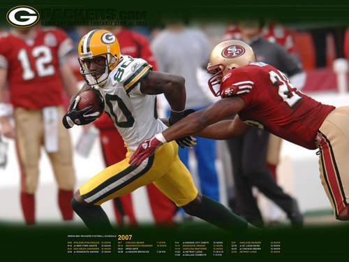 Green baía Packers wallpaper containing a tailback, a football helmet, and a atacante, lineman titled Donald Driver