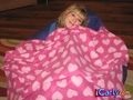 Sam wrapped up in a pink blanket