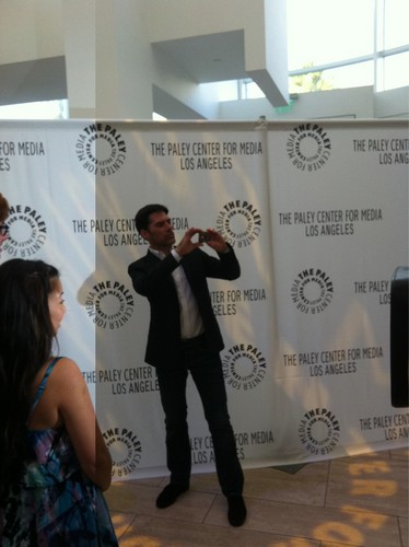 Thomas Gibson snaps a shot of the photogs