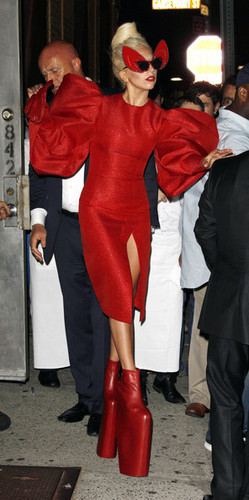 Gaga shows off a little thêm than she'd hoped in a red crotch revealing outfit.