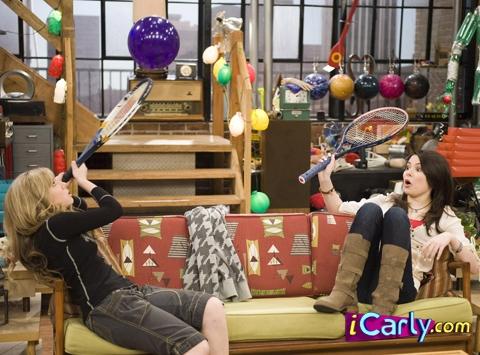 Carly & Sam playing tennis