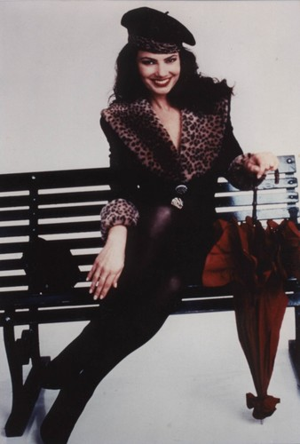 Fran Drescher Hintergrund possibly containing a hip boot and a well dressed person called Fran Drescher