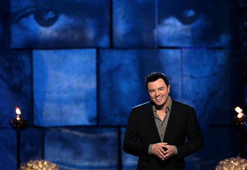 Seth MacFarlane wallpaper containing a business suit, a suit, and a dress suit entitled Seth MacFarlane @ the Comedy Central Roast Of Charlie Sheen