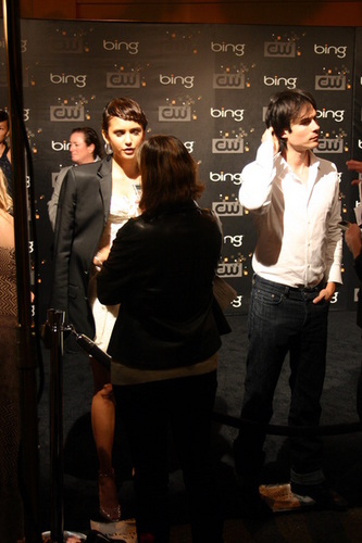 Ian Somerhalder and Nina Dobrev wallpaper possibly with a sign called nina with ian's jacket