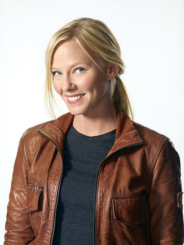 Kelli Giddish wallpaper possibly containing an overgarment, an outerwear, and a well dressed person called 'Chase' Photoshoot