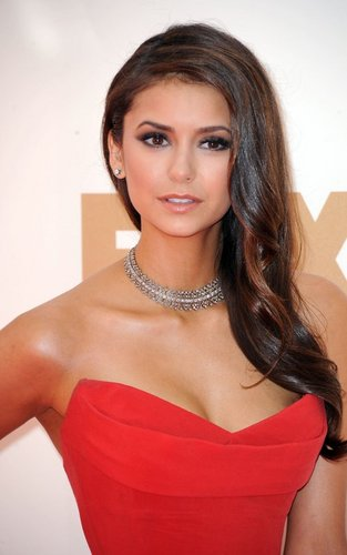 Nina Dobrev wallpaper probably containing a cocktail dress, attractiveness, and a bustier entitled  Nina Dobrev at the 63rd Primetime Emmy Awards (September 18).