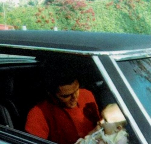Elvis Aaron Presley and Lisa Marie Presley wolpeyper with an automobile called Elvis & Lisa
