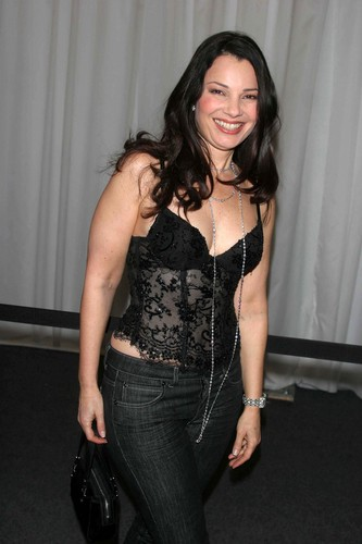 Fran Drescher Hintergrund possibly containing a pantleg, a hip boot, and long trousers entitled Fran