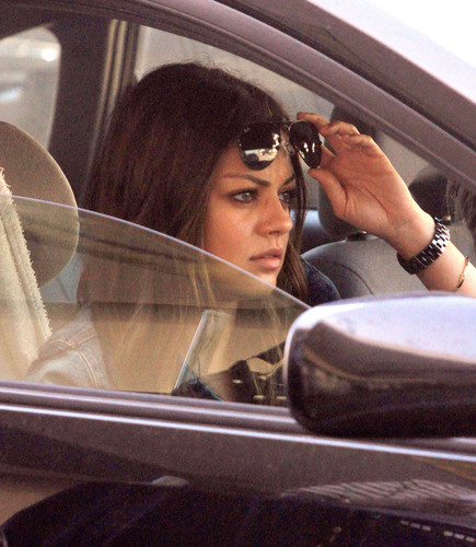 Mila Kunis Arriving For A Flight at LAX, Sep 18