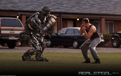 Filem kertas dinding with a wicket, a green beret, and a navy meterai entitled Real Steel