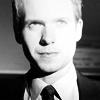 Suits photo containing a portrait titled Suits
