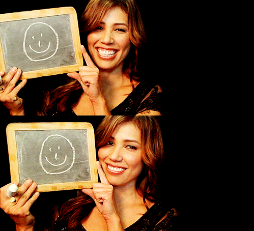 Michaela Conlin wallpaper with a sign and a laptop entitled Angie 2011