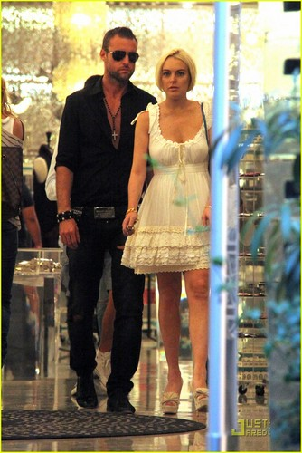 Lindsay Lohan wallpaper with a hip boot and a street called Lindsay Lohan & Philipp Plein: Milan Mates!