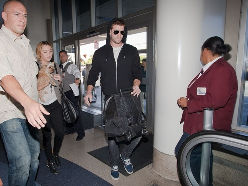 Miley - At LAX Airport with Liam, Tish & Billy Ray - September 27, 2011