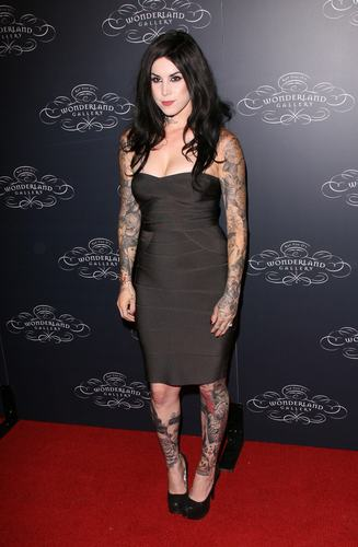 Kat Von D kertas dinding probably with a leotard, tights, and a koktel dress called Kat Von D's Wonderland Gallery Opening