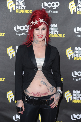Kat Von D wallpaper probably containing a hip boot and a sign called Logo's NewNowNext Awards