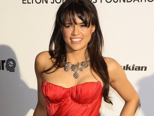Michelle Rodriguez wallpaper possibly containing a cocktail dress, a dinner dress, and attractiveness titled Michelle Rodriguez Wallpaper